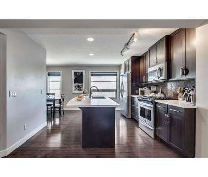 Sleek and Modern town home in beautiful Aspen Hills at 35 Aspen Hills Common Sw in Calgary AB is a House