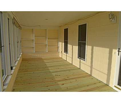 NC Island Living under $300,000 at 188 Sheldon Road in Atlantic Beach NC is a Single-Family Home