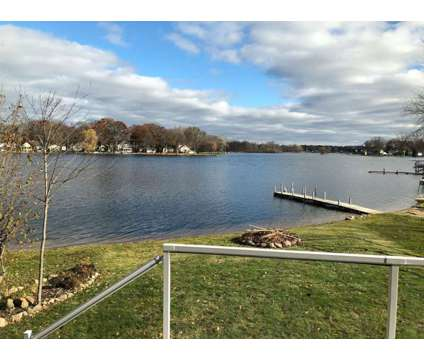Waterfront Lake Chemung House for Sale at 5415 Wildwood Drive in Howell MI is a Single-Family Home
