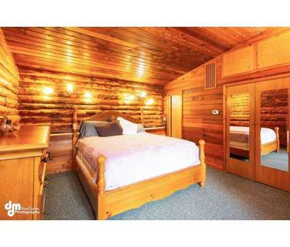 Beautiful Log Home at 6101 E 162nd Ave in Anchorage AK is a Single-Family Home
