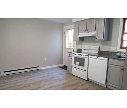 2 BD/ 1BA Newly Renovated Townhouse for Rent at 4 Rev. Robert Costello Pl. in Boston MA is a Apartment