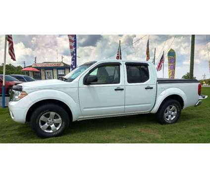 2012 Nissan Frontier Sv V6 2wd Crew Cab is a 2012 Nissan frontier SV Truck in Cartersville GA