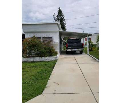 Mobile Home at 16940 Us Hwy 19 N Lot 409 in Clearwater FL is a Mobile Home