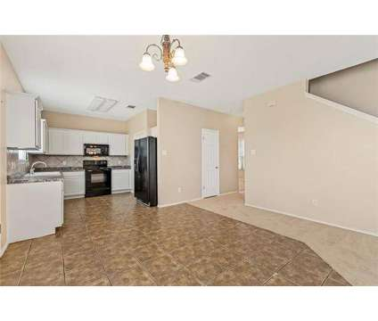 MOTIVATED SELLER! Bring an offer! NEW carpet, paint and refinished cabinets! at 107 Meadow Lark Ln in Hutto TX is a Real Estate and Homes