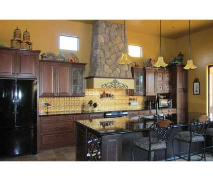 Gorgeous Custom Tuscan Style Home 4 SALE BY OWNER -get out of the cold and move at 3719 N Canyon Crest Place in Apache Junction AZ is a Single-Family Home