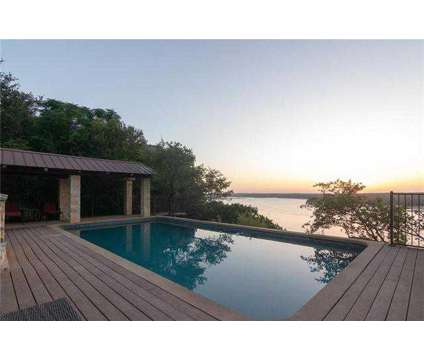 Incredible Lake Travis waterfront estate on 3.4 acres with panoramic Lake Travis at 3110 Ranch Road 620 in Austin TX is a Single-Family Home