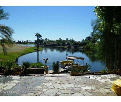Luxury lakefront with pantoon boat and a mile of golf course in Scottsdale AZ is a Single-Family Home
