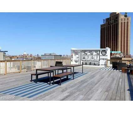 Amazing Wicker Park 2 Bed 1 Bath Rooftop, In Unit W/D, Huge Bedrooms at 2040 W North Ave in Chicago IL is a Apartment