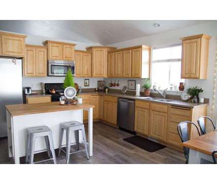 Beautifully maintained home in a wonderful family friendly neighborhood at 1215 W 3140 N in Lehi UT is a Single-Family Home