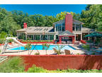 Online Auction - Spectacular 13,000 SF Home with Pools, Ponds & Guest House
