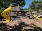 Swing Set with tube slide and tower (El Paso Country Club)