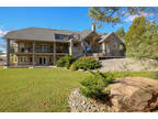 Peaceful luxury meet with the dramatic backdrop of this 35 acre estate