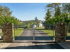 Iconic estate with 2 homes on acrage