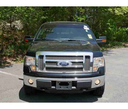 Used 2010 Ford F-150 4WD SuperCrew 145 is a Black 2010 Ford F-150 Car for Sale in Pembroke MA