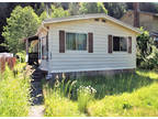 Mobile home on residential lot in Zeballos, BC