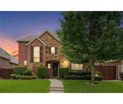 3879 Frio Way FRISCO Four BR, Stone & brick front elevation with at 3879 Frio Way in Frisco TX is a Real Estate and Homes