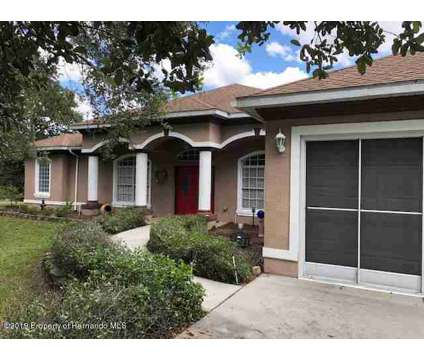 8483 Foxboro Lane SPRING HILL Three BR, Stunning custom built at 8483 Foxboro Ln in Spring Hill FL is a Real Estate and Homes