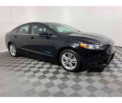 2018 Ford Fusion Hybrid SE is a Black 2018 Ford Fusion Hybrid SE Hybrid in Maple Shade NJ