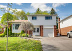 Gorgeous Updated Four BR Two BA Side-Split Combines Rare Privacy And Spacious