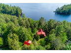 Majestic 4-season setting with expansive natural shoreline views on beautiful
