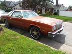 1976 Orange Oldsmobile Cutlass Supreme