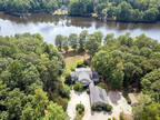 LAKEFRONT on 20 acres!