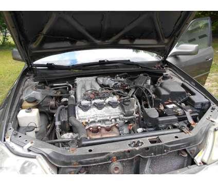Car is a 2003 Toyota Avalon Sedan in Hanson MA