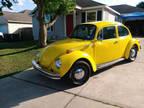 1974 Yellow Volkswagen super beetle