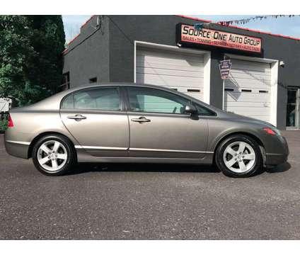 2006 Honda Civic EX Manual Sedan is a 2006 Honda Civic EX Sedan in Schwenksville PA
