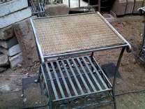 2 matching heavy-duty iron patio tables