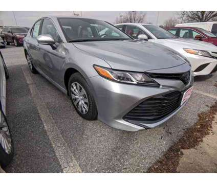 2020 Toyota Camry Hybrid LE is a Silver 2020 Toyota Camry Hybrid in Clarksville MD