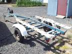 BOAT TRIALER will take up to a 22 ft boat -