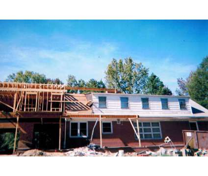its a great day to remodel your home is a Construction & Remodeling service in Chester VA