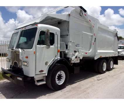2010 Peterbilt 320 Heil Front Loader Garbage Truck is a 2010 Other Commercial Truck in Miami FL