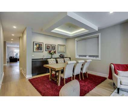 Lincoln Park 4 Bedroom Duplex Move-In Ready at 2649 N Mildred Ave in Chicago IL is a Condo
