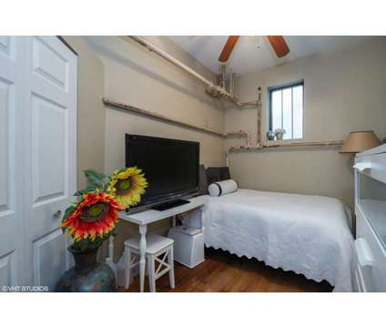 Loft-Like Edgewater 2 Bedroom at 1301 W Elmdale Ave in Chicago IL is a Condo