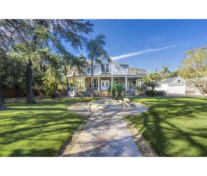 Gorgeous Victorian estate with permitted guest house at 4833 Morella Ave in Valley Village CA is a Single-Family Home