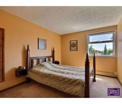Two bedroom condo at 212-8604-48ave,nw, 212 in Calgary AB is a Flat