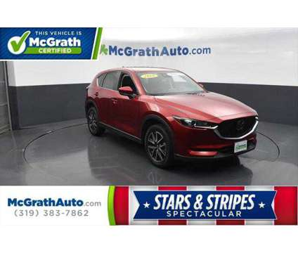 2018 Mazda CX-5 Touring is a Red 2018 Mazda CX-5 Touring SUV in Dubuque IA