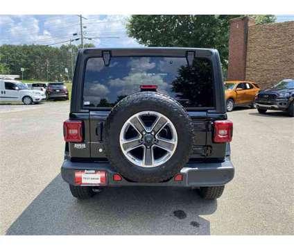 2018 Jeep Wrangler Unlimited Sahara is a Black 2018 Jeep Wrangler Unlimited Sahara SUV in Canton GA