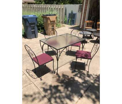 Uniquely cool glass table with 4 chairs - Over 50 years old is a Tables & Stands for Sale in Hutchinson KS
