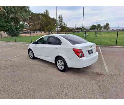 2013 Chevrolet Sonic for sale is a White 2013 Chevrolet Sonic Car for Sale in Apple Valley CA