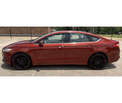 2014 Ford Fusion for sale is a Red 2014 Ford Fusion Car for Sale in Shreveport LA