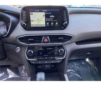 2019 Hyundai Santa Fe is a Orange 2019 Hyundai Santa Fe SUV in Newnan GA