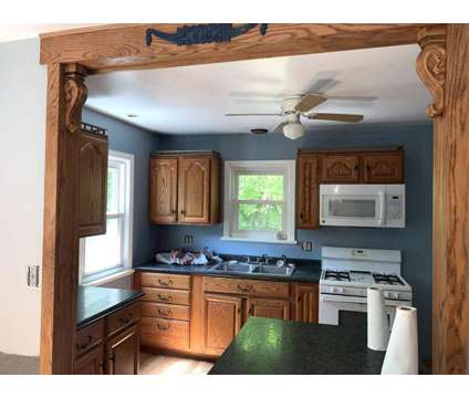 2 bed 1 bath brick house in heart of N PGH community with garage yard and baseme at 1015 Willow Drive in Pittsburgh PA is a Home