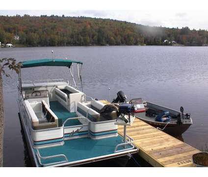 Lake house at 8 Spruce Street in Milan NH is a Vacation Home