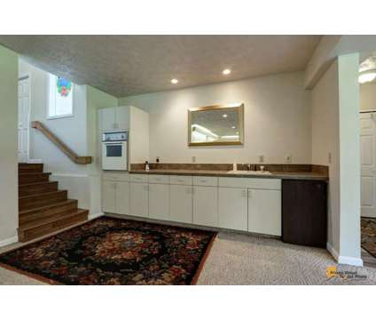 Hillside 3 BDRM Home w/ Large Family Room FOR SALE at 9321 Strutz Ave in Anchorage AK is a Single-Family Home