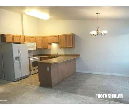 UMED District Spacious Townhome Triplex FOR SALE - at 5549-5553 E 43rd Ave in Anchorage AK is a Multi-Family Real Estate
