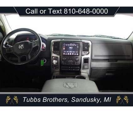 2015 Ram 1500 Sport Crew Cab 4x4 is a Silver 2015 RAM 1500 Model Sport Truck in Sandusky MI