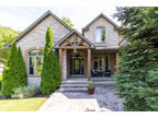 Incredible Custom-Built 5 Bedroom Home on Picturesque Ravine Lot!